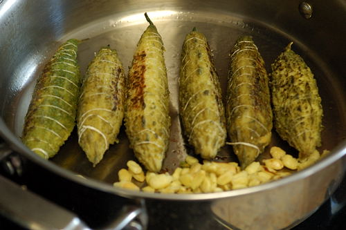 Sauteeing the steam-cooked karelas and karela seeds