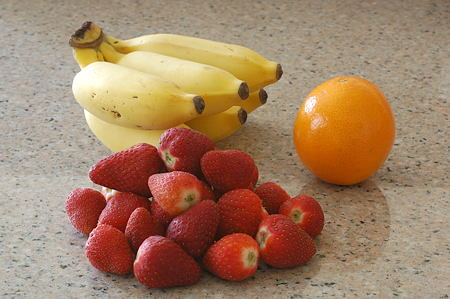 Strawberries, Bananas and an Orange